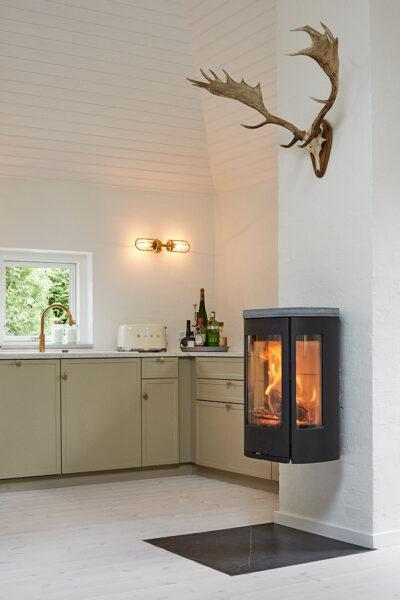 Guesthouse de luxe rummer et lækkert Kvänum-køkken og brændeovn.